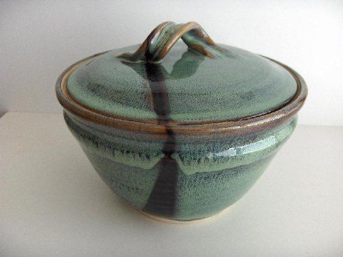 CASSEROLE - PONDEROSA by RISING SKY POTTERY. $68.50. Hand-thrown stoneware covered casserole by New Mexico potter R. Rising of Las Cruces. Volume 2 quarts. Approximately 5 inches tall and 9 inches in diameter. The colour shown is called PONDEROSA.