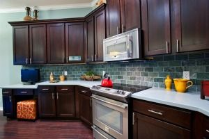 Blue Backsplash With Dark Cabinets For The Home Kitchen