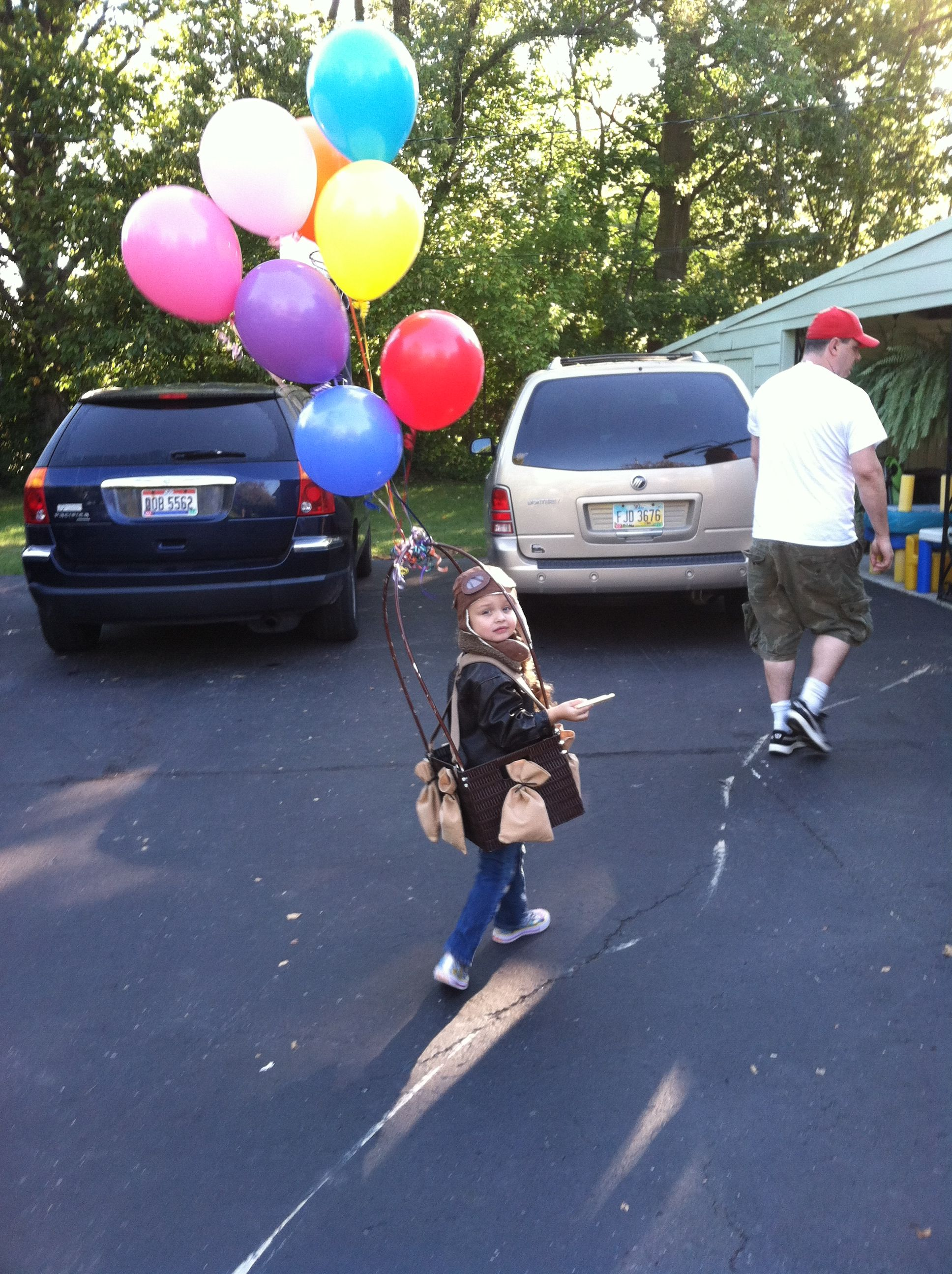 Home made Halloween. Made my daughter a hot air balloon costume. Completed look with bomber jacket and aviator cap and goggles.