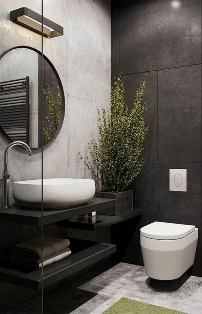 salle de bain en noir, blanc et gris, grand miroir rond au cadre fin - salle de bain meuble noir