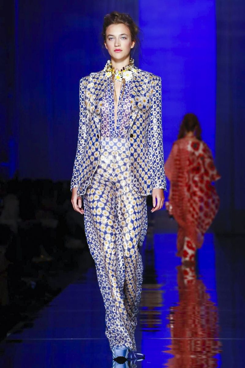 Leave it to Jean Paul Gaultier, the man who still knows how to put a skip in your fashion step, to do something a little different. Because the here-comes-the-bride moment has become a little predi...