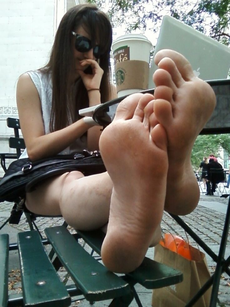 Brunette Shows Her Dirty Soles In Public