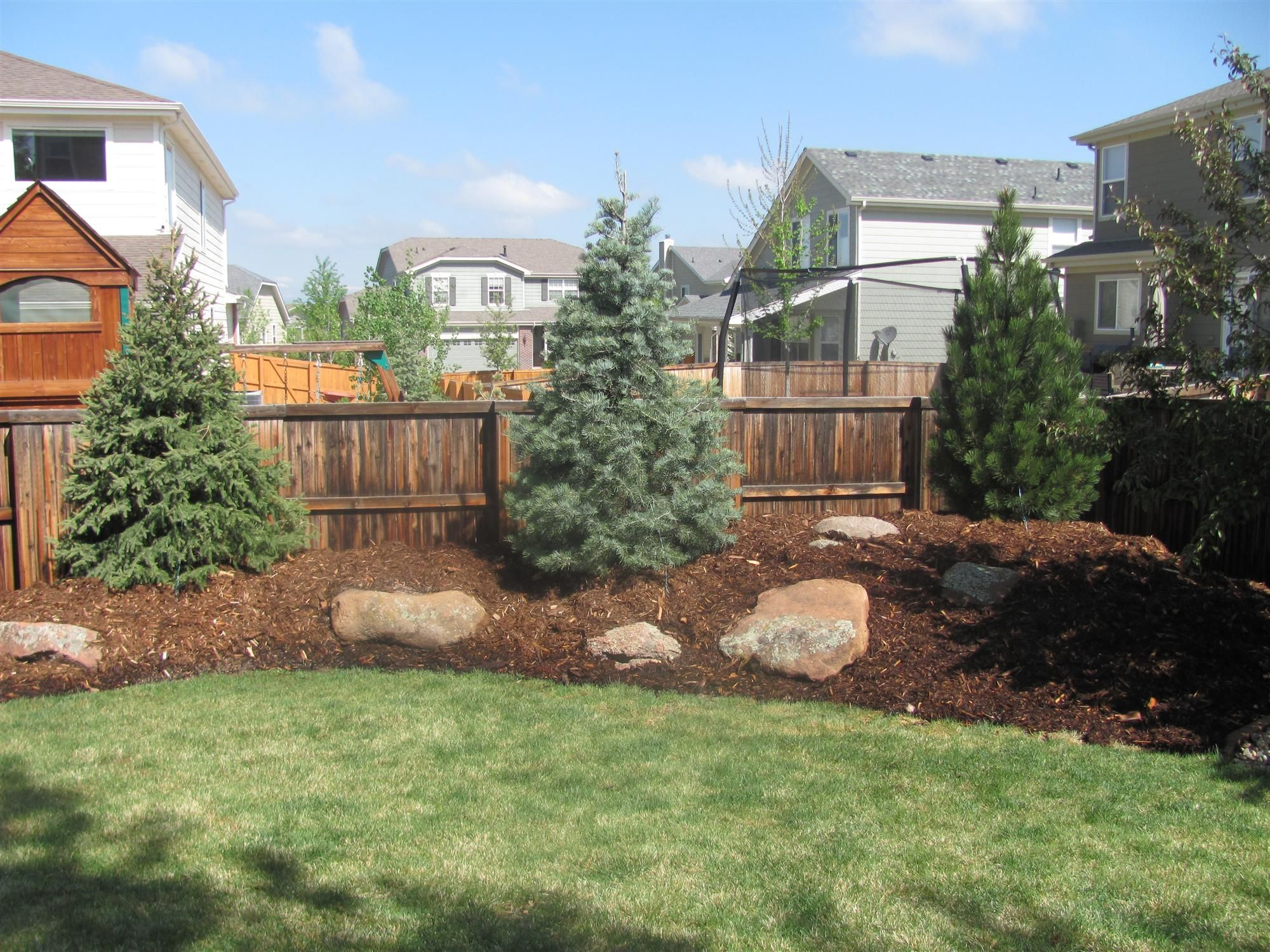 Similar to my back fence my trees are full size no rocks for Mountain landscape design