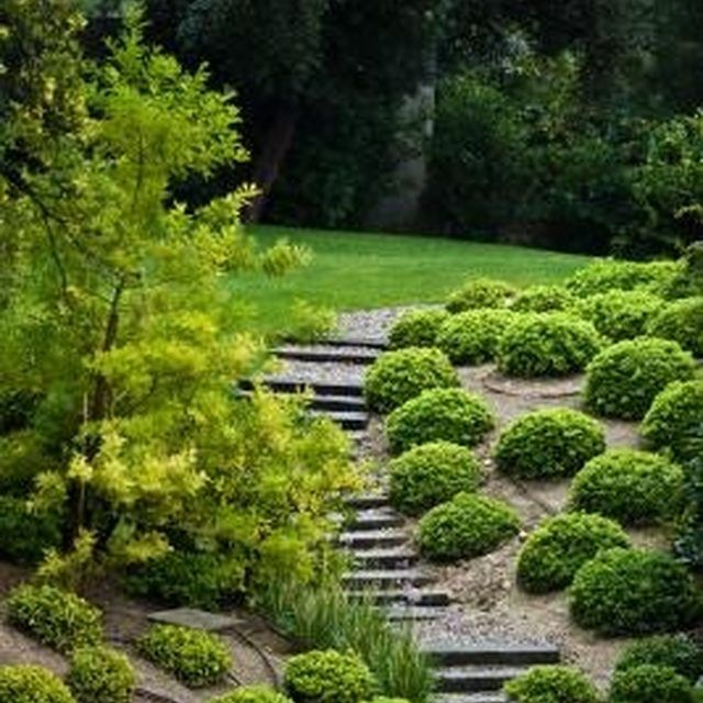 How To Build Dry Creek Beds For Landscape Drainage Easy Backyard Landscaping Backyard Landscaping Landscaping On A Hill