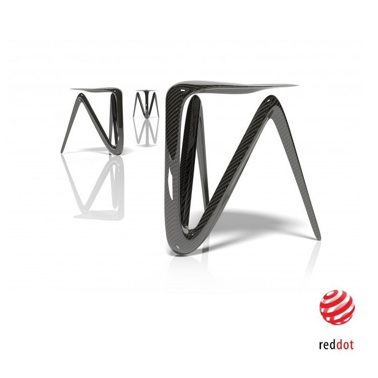 Plum is a futuristic looking carbon fiber stool by New York designer Alvaro Uribe. It is created by bending the material at key stress points and creating structural ribs. The aerodynamic form of the Plum Carbon Fiber Stool emulates the way that natural forms grow and evolve, always aiming for efficiency and it is born by using the least amount of material. These ribs are similar to the stem of a leaf, or the shaft of a feather, which give additional resistance to pressure and compression…