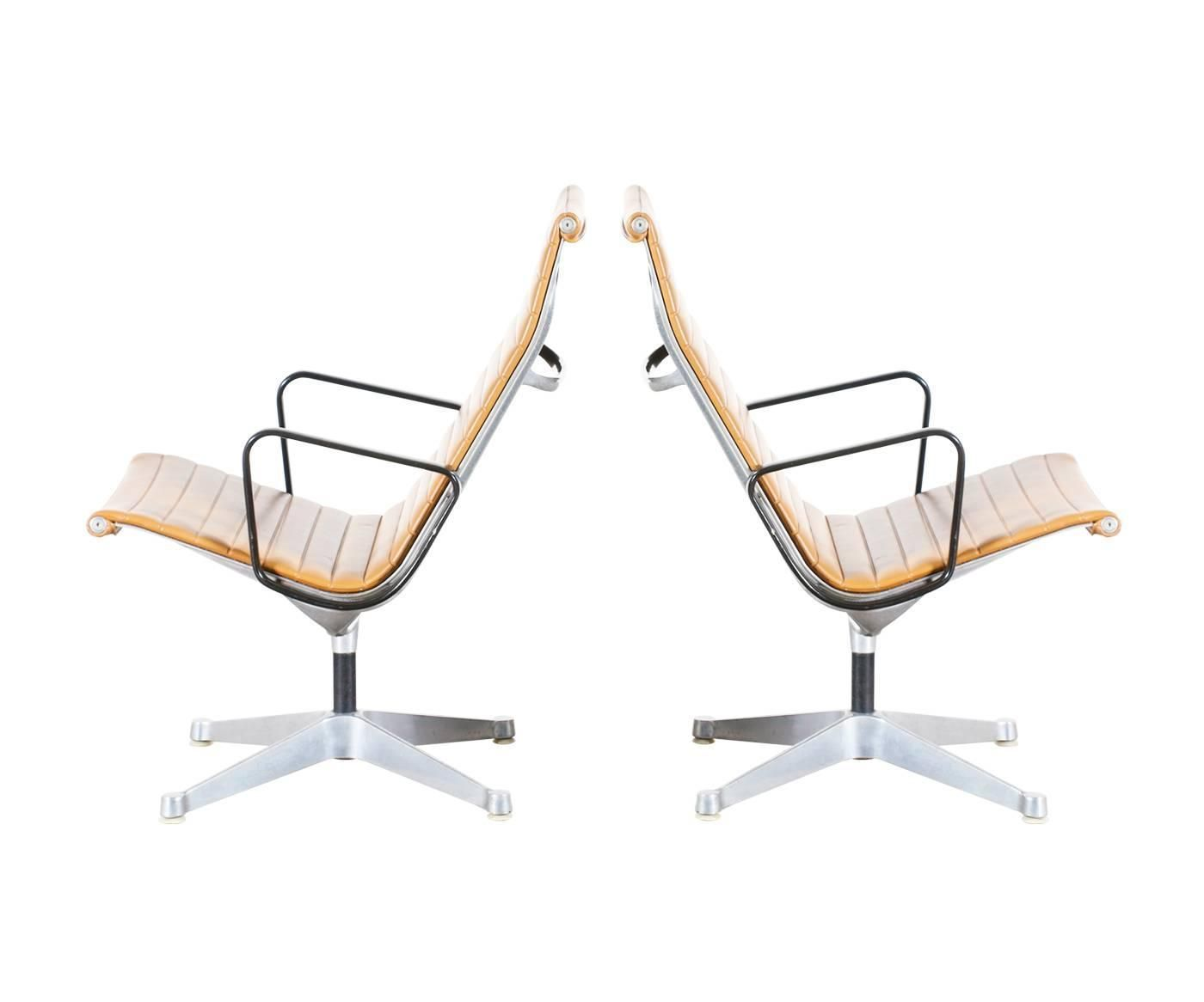 charles ray eames aluminum group tan color lounge chairs