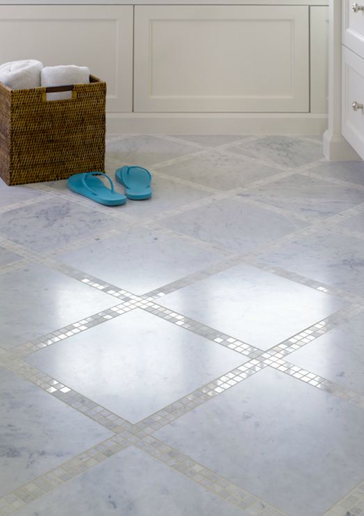 Bathroom floor with marble tiles and marble mosaic inset tiles. I LOVEEE THIS LOOK! So clean looking, can't stand grout.