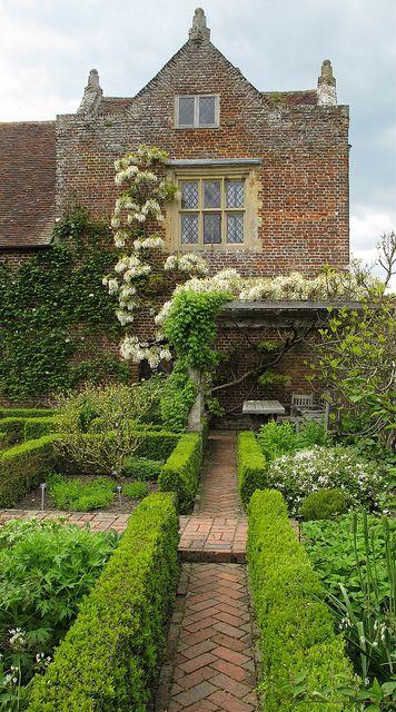 White garden |Sissinghurst Potager Espalier brick formal herringbone paver walkway