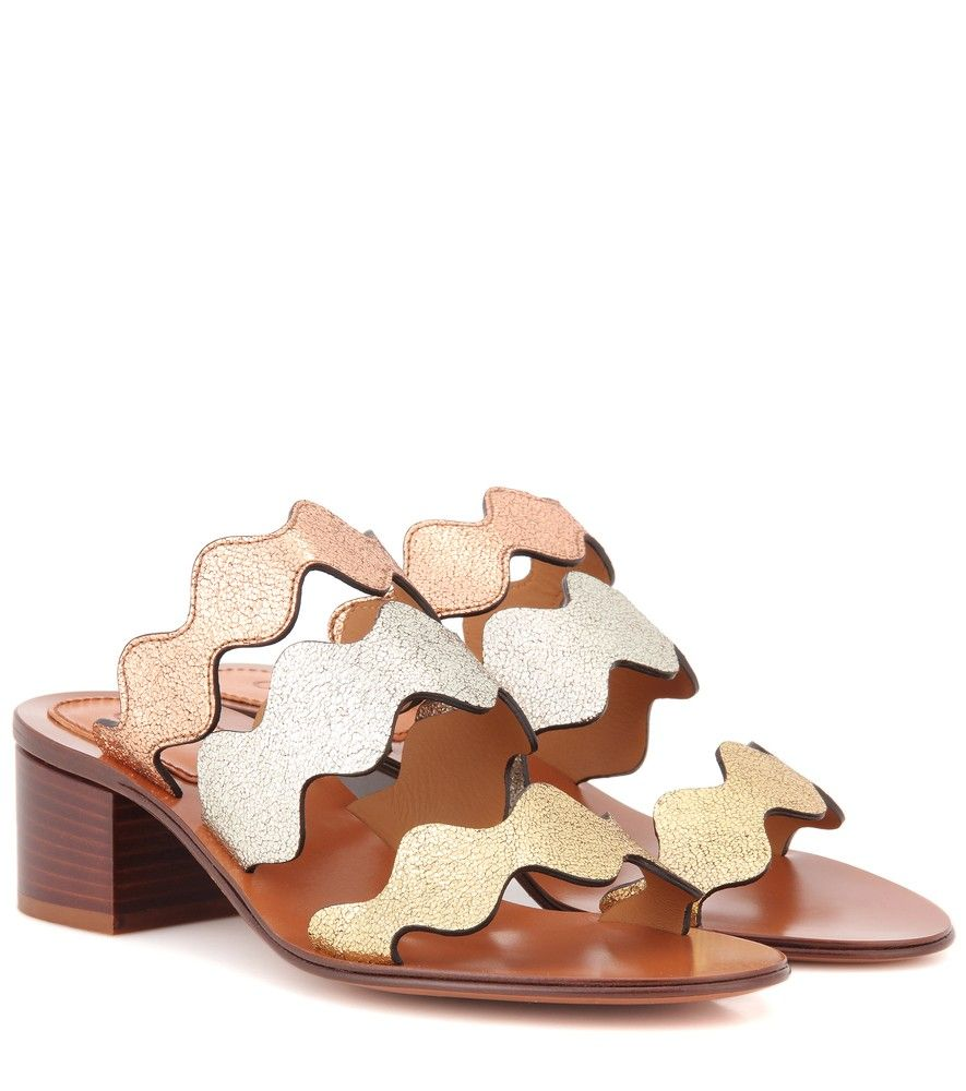 Chloé - Lauren leather sandals - Bringing a modern twist to the Lauren line's iconic scallop trim, this effortlessly elegant sandal from Chloé is set to be a summer wardrobe staple. Romantic and feminine while channeling a cool attitude with a comfortable slip-on design, you'll be reaching for this pair time and time again. Style yours with flowy summer dresses and cut-off jeans alike. seen @ www.mytheresa.com
