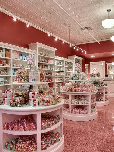 82e91779c4b2 Confectionery Store-- love the white shelving against the pink walls.