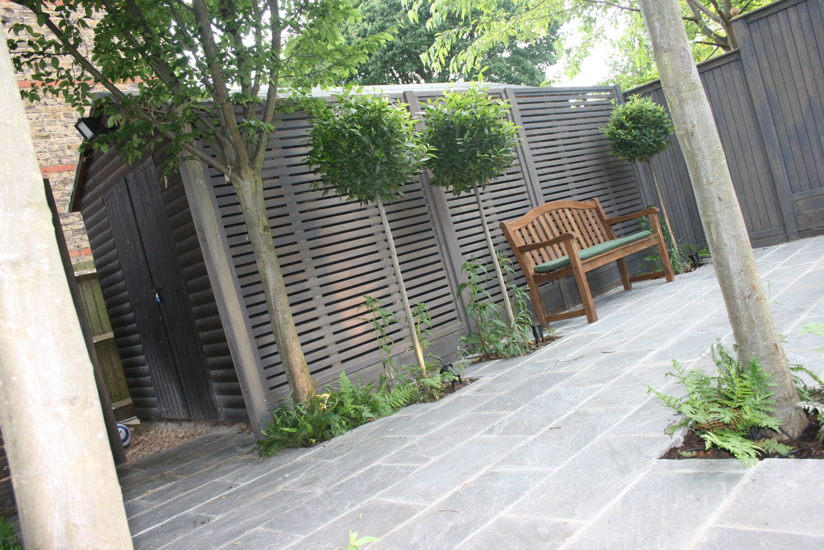 GREENLINESDESIGN Ltd / Shaded seating area in this Family ...