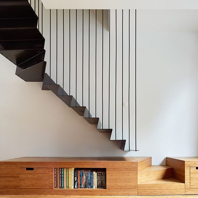 Best A Slender Folded Metal Staircase Sits Above A Bamboo 400 x 300