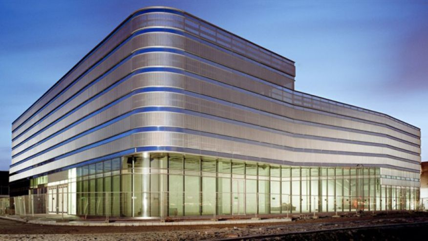 Minimalist Parking Garage - Veranda Car Park - mirrored glass, aluminum, & steel structure blends skyline and natural light
