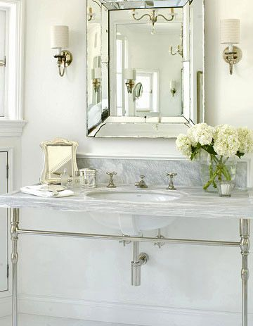 Pale Gray Marble Countertop  When luxury is a must and price is no option, opt for marble. This pedestal vanity, constructed from pale gray marble, continues up into the wall for a low backsplash. The cloudlike color scheme of whites and grays creates a relaxing yet elegant ambiance that starts with the countertop.