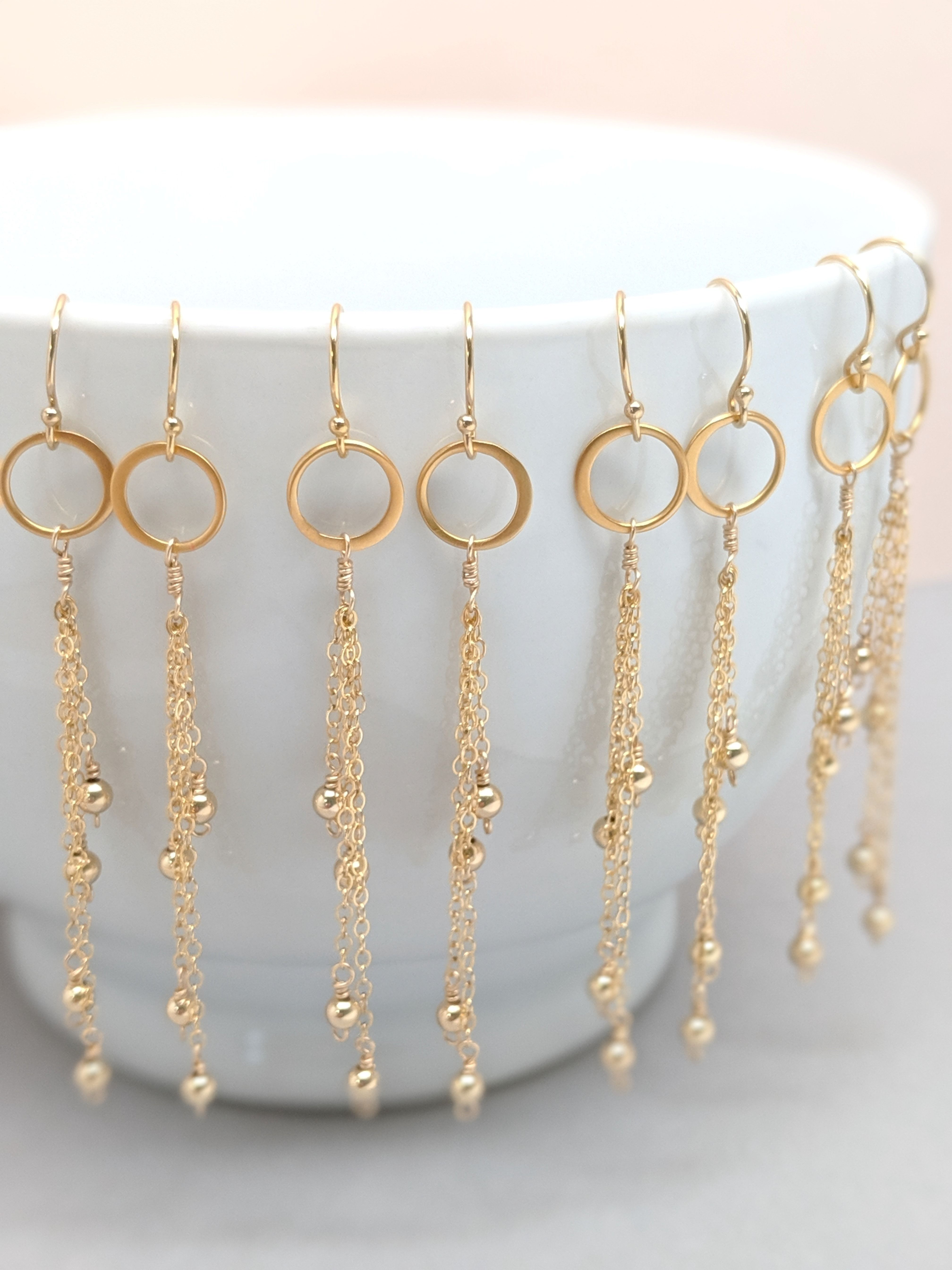 You will love these long chain dangle earrings. Attached to a dainty circle hoop and tiny gold beads. These come in silver or gold and are perfect for you or make meaningful gifts!