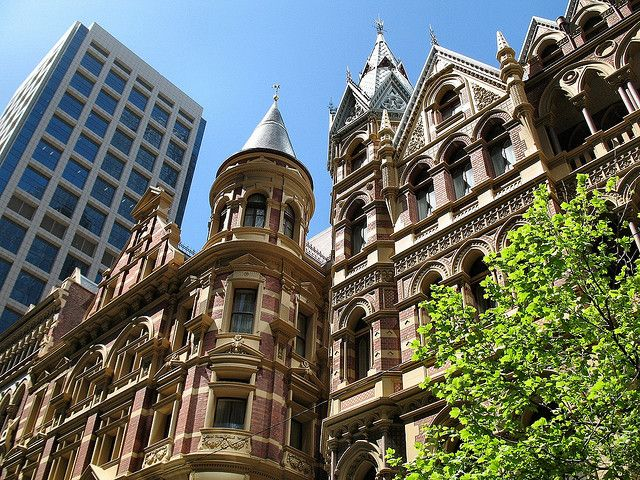 Winfield & Rialto Buldings Melbourne.  On the left is the Queen Anne styled Winfield Building built in 1891 and on the right is the Neo-Gothic styled Rialto Building from 1889. Both buildings were restored some years ago and turned into a five star hotel.