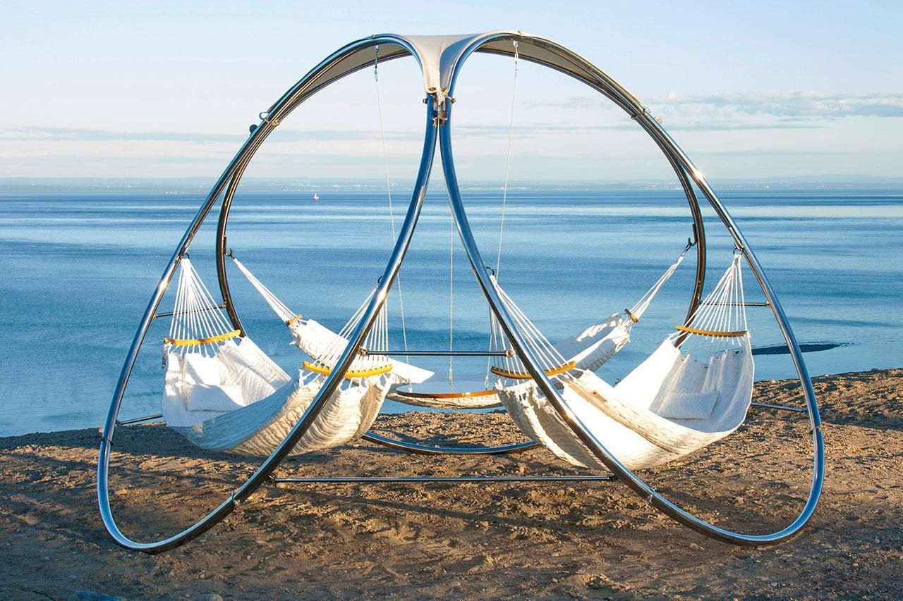 Triple hammock hanging from a circular structure - so relaxing