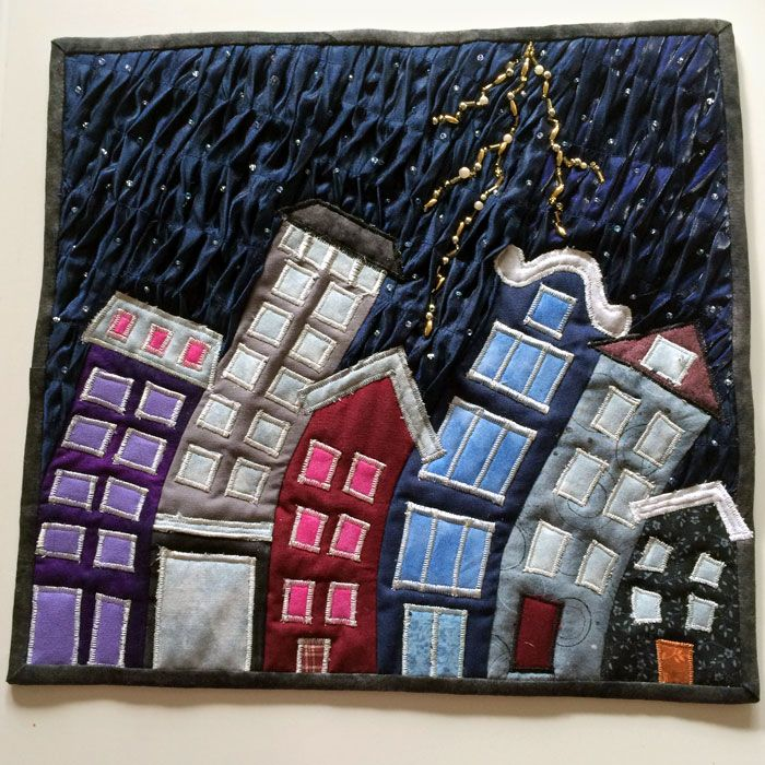 WEATHER challenge mini quilt at Fria Tyglar quilt group (Sweden): these houses are really bending in the wind! 3D pintucked background
