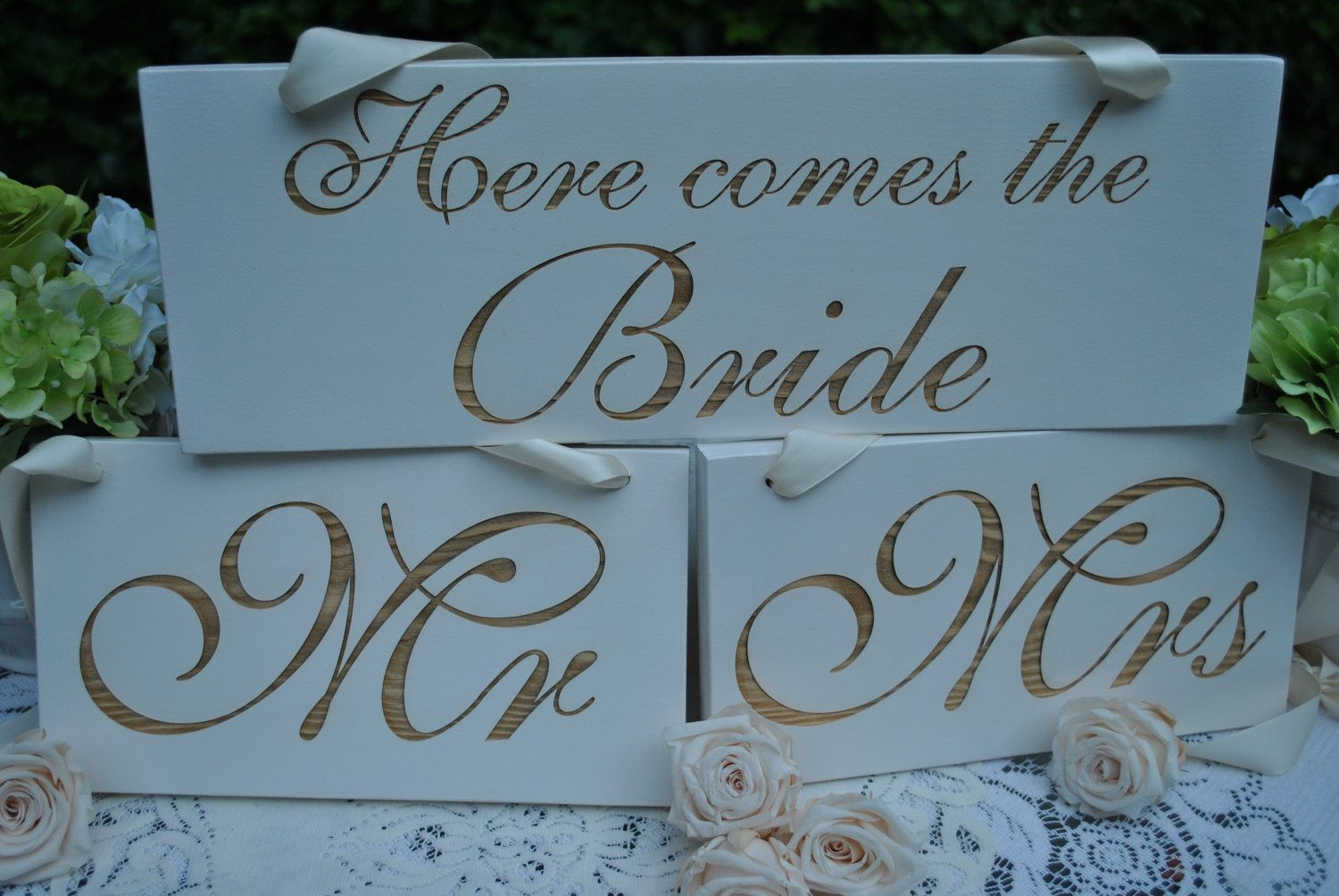 """Wedding Sign Set: """"Here comes the bride"""", """"Mr"""", and """"Mrs"""" handpainted engraved wood signs. $56.00, via Etsy."""