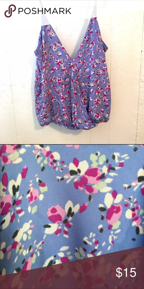 Lilac Tank Top Lilac floral tank top. Thin cool material, very V-cut. Cinched at the bottom. Worn but is in great condition. No tears, stains, etc. Tops Tank Tops