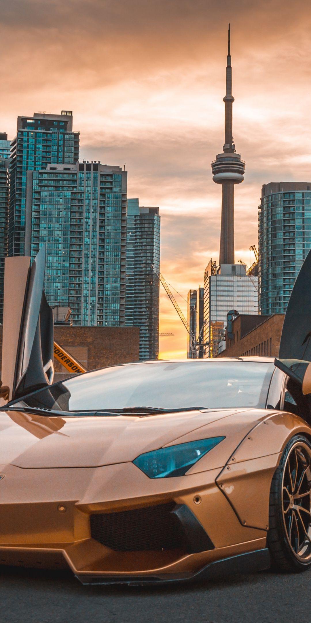 Golden Lamborghini Aventador, CN tower, 1080x2160 wallpaper is part of Luxury cars audi -