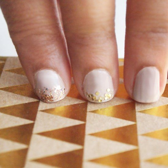 A trendy nude and gold glitter mani DIY. Fix your chipped manicure all at the same time!