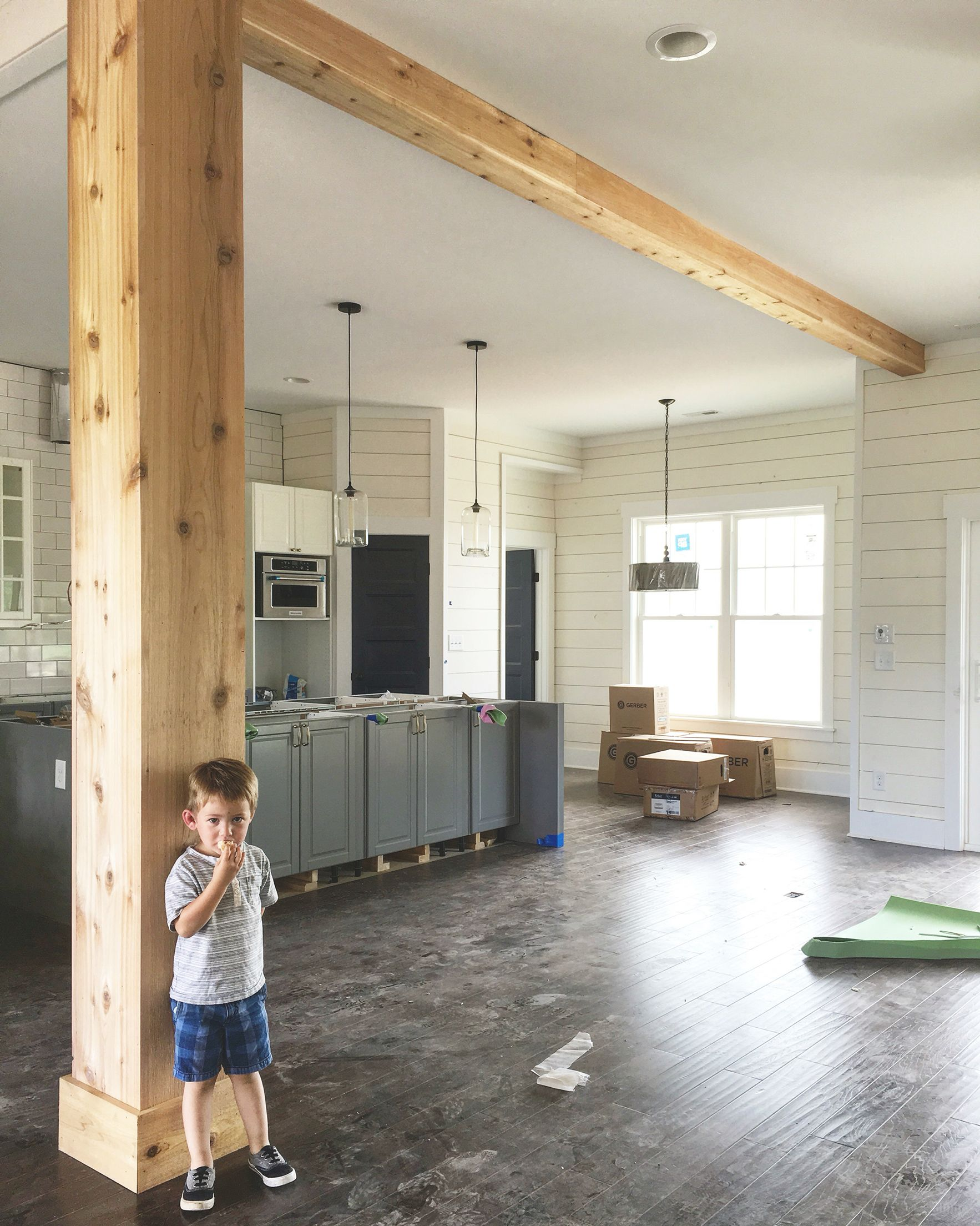 Support beam wrapped in cedar interior barn doors for 6x6 room design