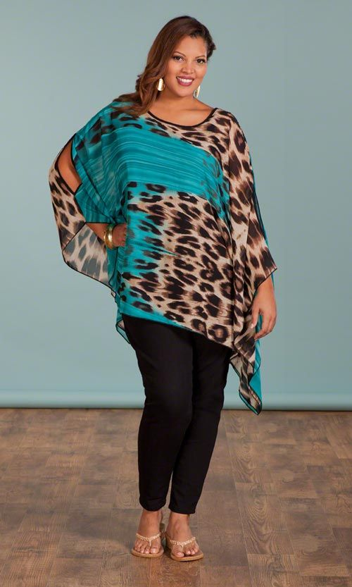 SOPHISTA-ROAR PONCHO & SKINNY JEANS | Named by you from our Name it to Win it Contest! |  Our Sophista-Roar Poncho evokes thoughts of island breezes and fierce women | Sheer, woven fabric | Asymmetrical hemline | Round neckline | Bracelet length sleeves | 100% polyester  #plussize #plussizefashion #summer #summerblouse #contest