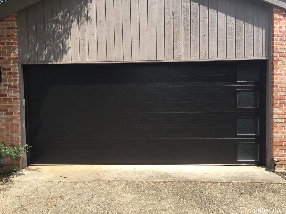 New Install Clopay Modern Black Garage Door With Vertical Windows Black Garage Doors Garage Doors Modern Garage Doors