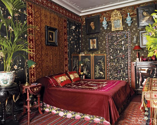 Baroque And Symbolist Paintings Hang On The Bedroom Walls, Which