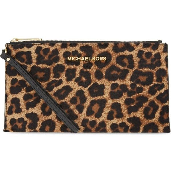 edcfeee63cfb MICHAEL MICHAEL KORS Cheetah print zipped clutch ( 200) ❤ liked on Polyvore  featuring bags