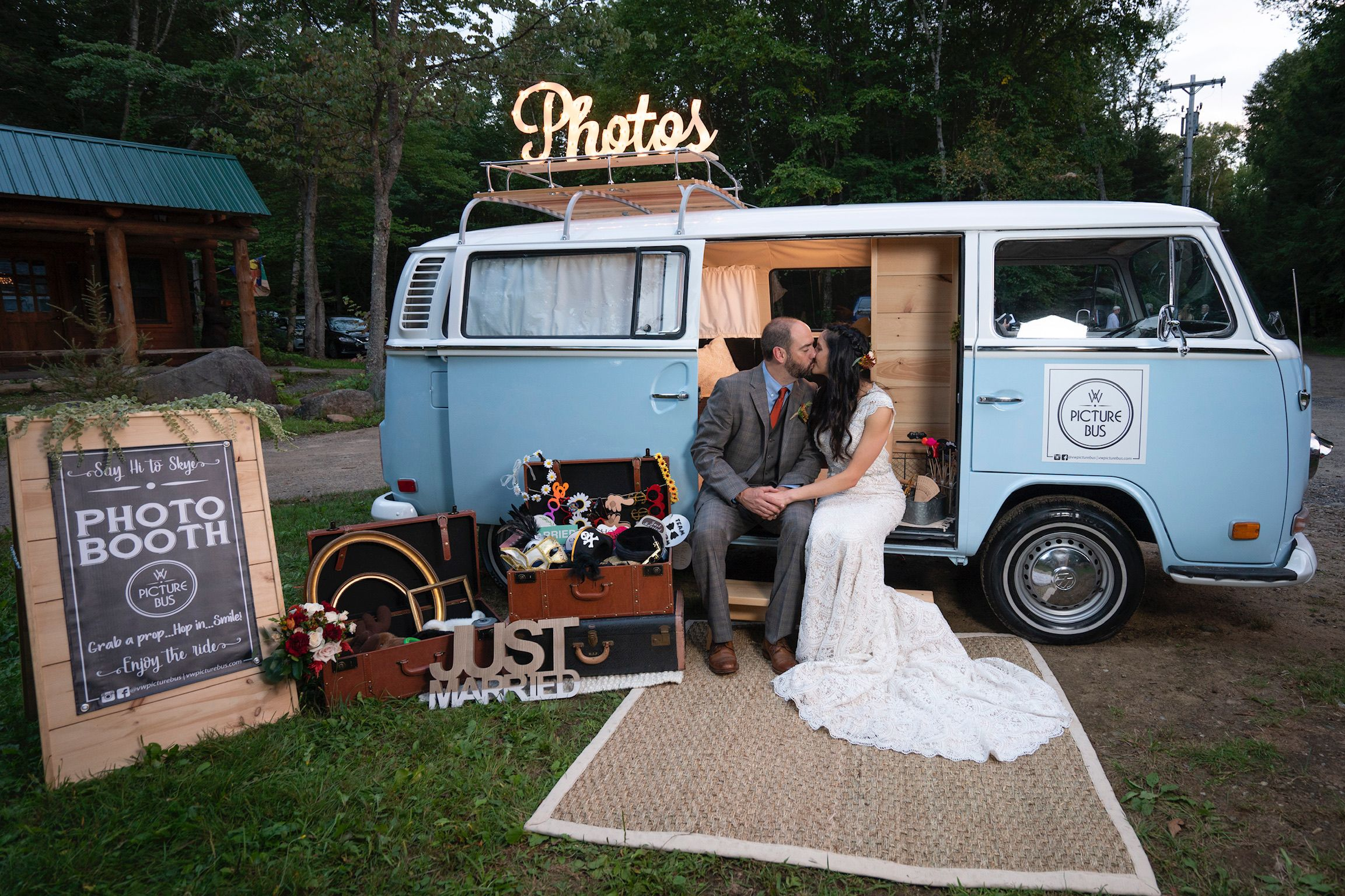 Bride and groom take picture with vw photo booth bus k