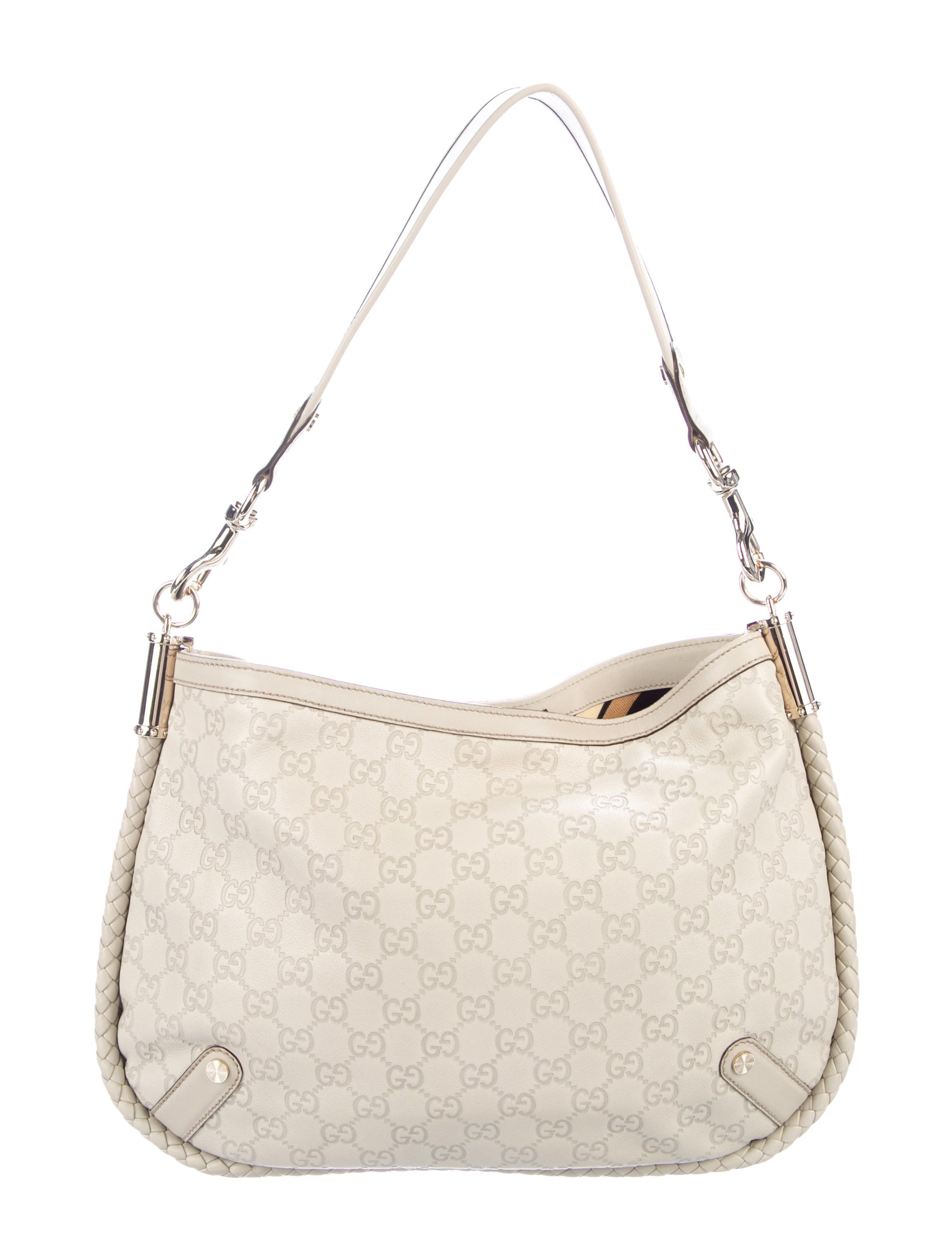 f5c66d5b6d7b Creme Guccissima leather Gucci Medium Britt hobo with gold-tone hardware,  single flat shoulder strap, single pocket at front with snap closure, black  and