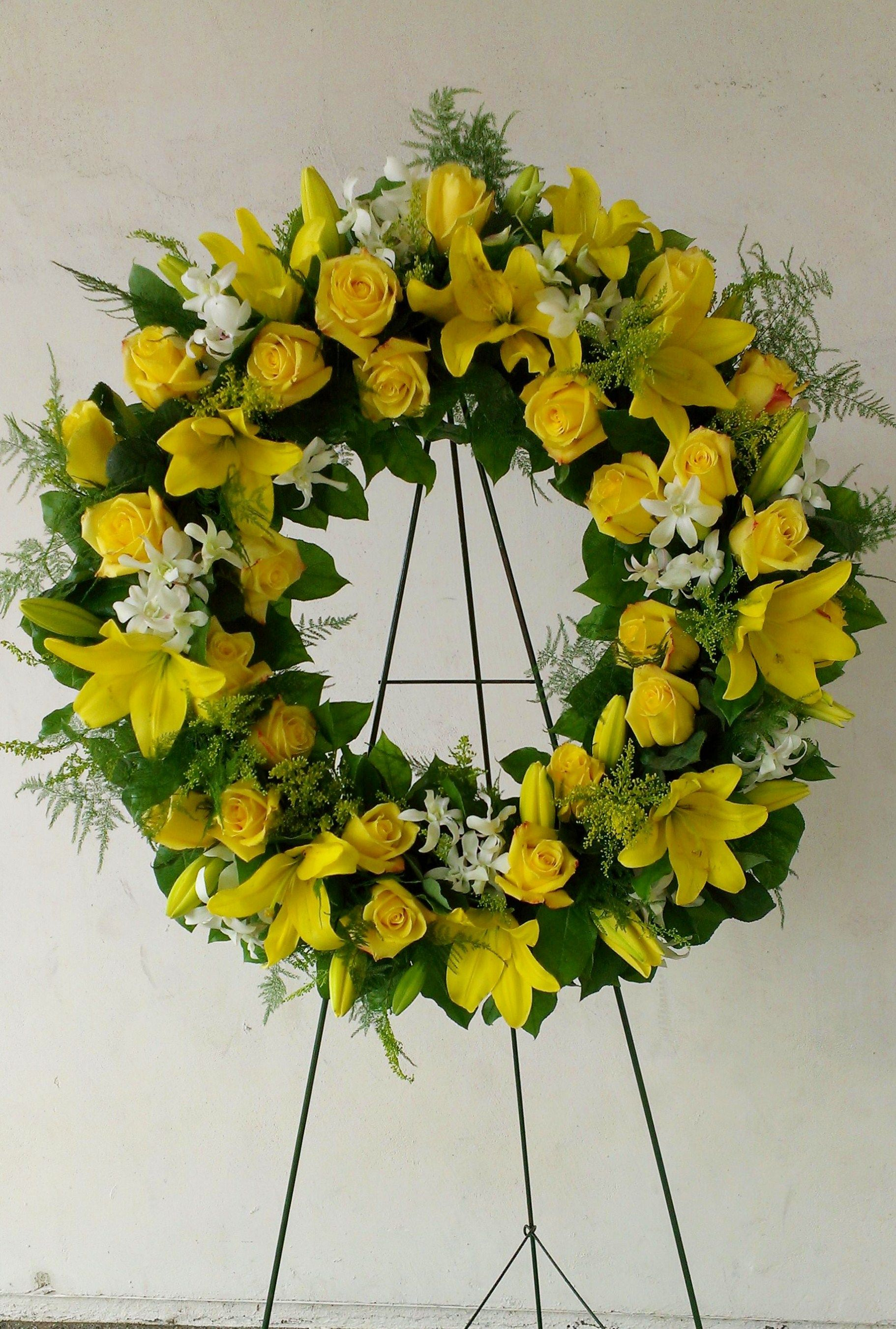 Yellow funeral wreath with roses lilies and dendrobium orchids yellow funeral wreath with roses lilies and dendrobium orchids casket flowers grave flowers izmirmasajfo