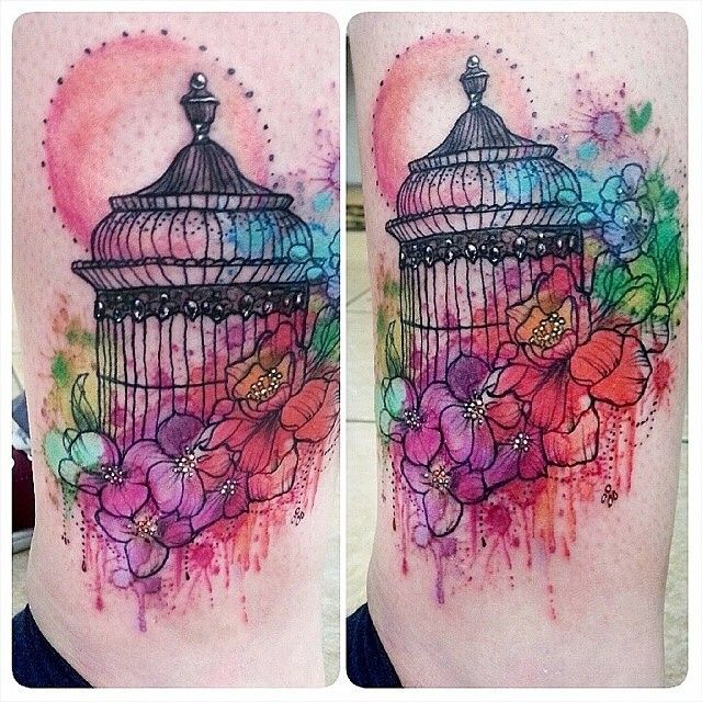 Watercolour birdcage tattoo. The line work on this is HORRIBLE. The piece as a whole just looks messy.