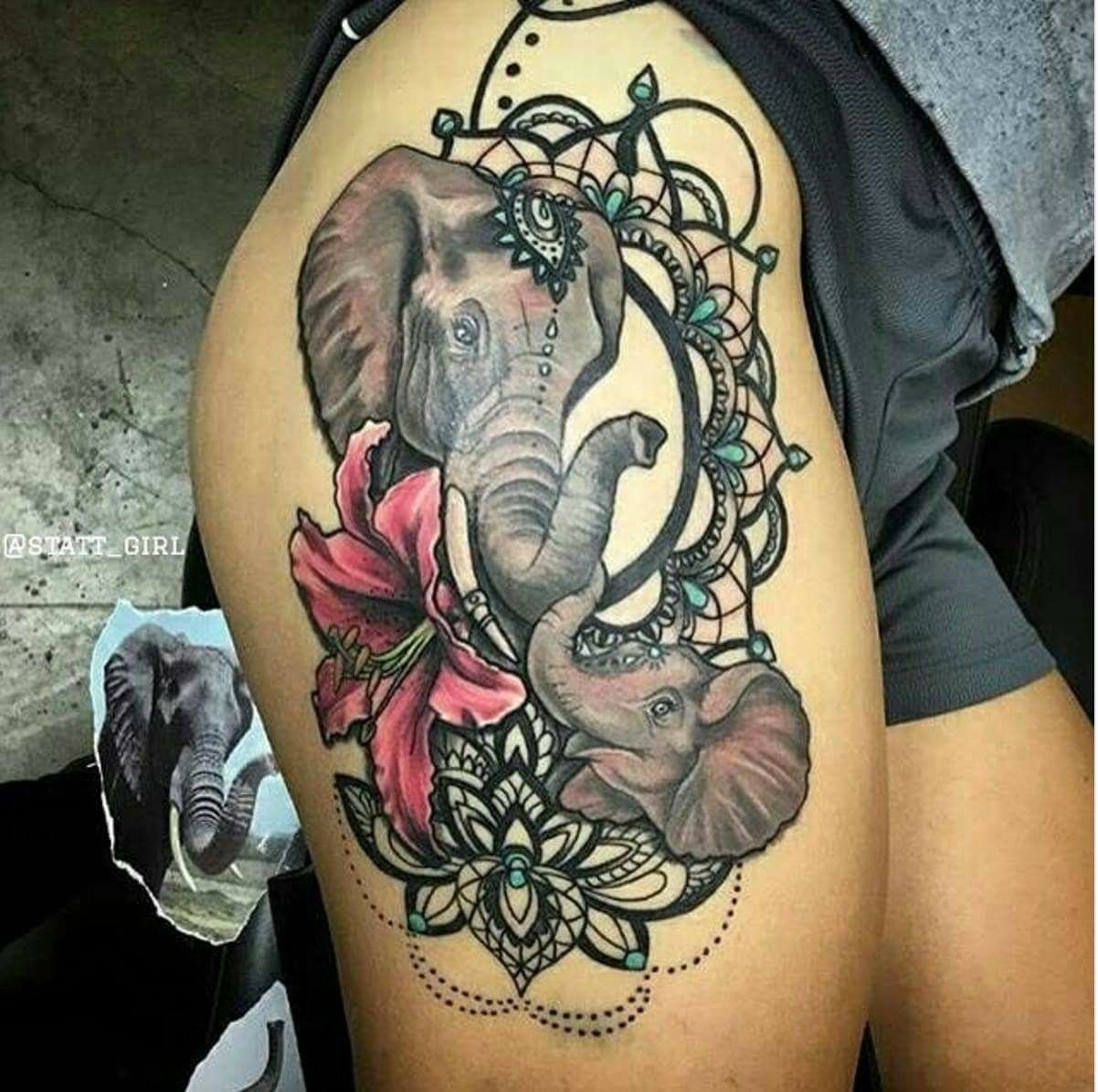 Elephant tattoo tattoos pinterest elephant tattoos tattoo and lily flower and elephant heads with mirror frames tattoo on side thigh izmirmasajfo