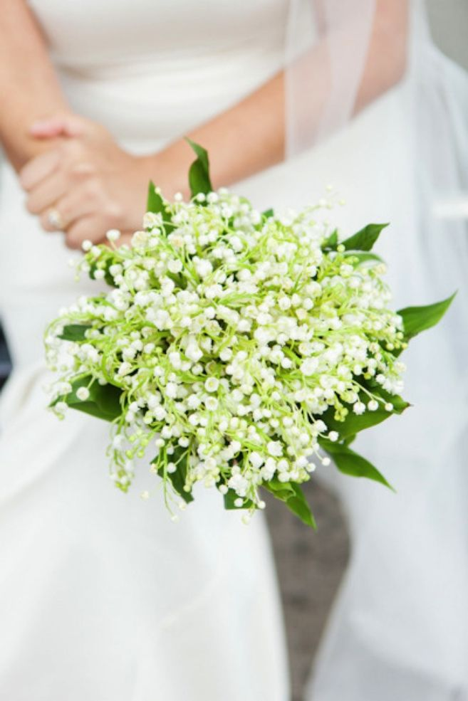 Kate Middleton used Lily of the Valley in her bouquet. It is understated and classic, which keeps all the attention on the bride.     Image via  Time to Drink Champagne.