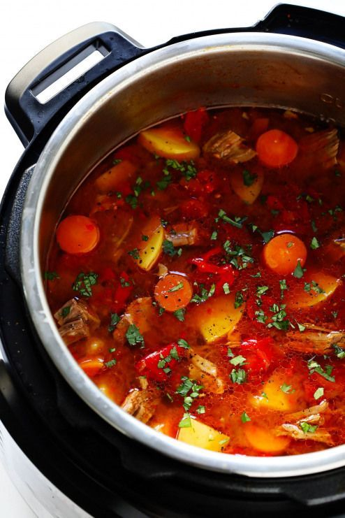 this Mexican Vegetable Beef Soup recipe! It's easy to make in the Instant Pot (pressure cooker) Crock-Pot (slow cooker) or on the stovetop. And it's full of tender steak potatoes carrots roasted red peppers tomatoes and simmered in a delicious tomato chile broth. High recommend topping this stew with lots of fresh cilantro and avocado!LOVE