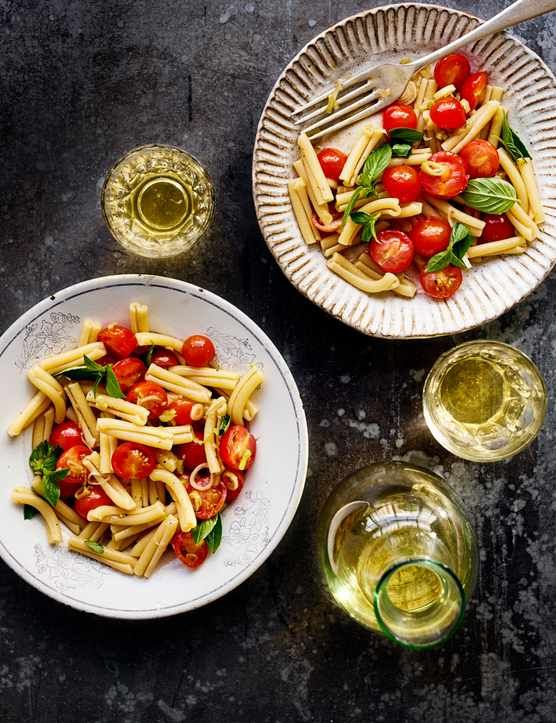 This vegan casarecce with raw tomato sauce recipe is super simple and only takes 15 minutes to make. Casarecce is a twisted short pasta that retains a good bite, perfect for simple pasta dishes