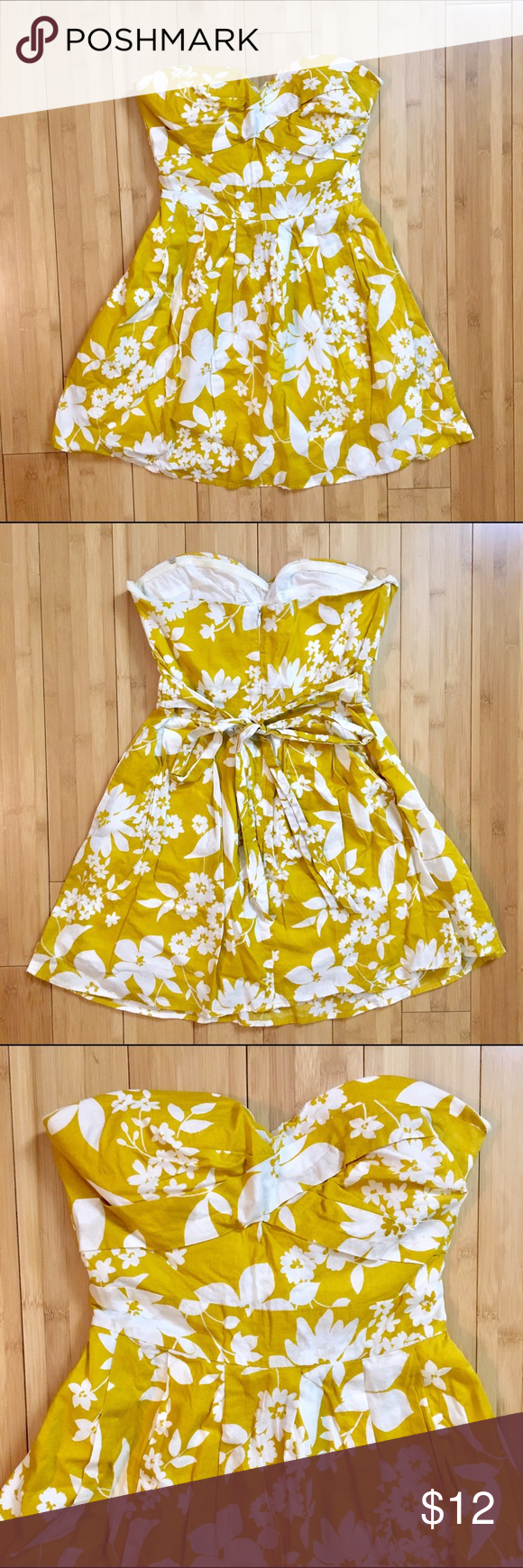 Forever 21 Mustard Yellow Floral Strapless Dress Size Small. True to size. Doesn't fit me anymore but the 4th picture is when it used to fit me. Yellow mustard color with white floral pattern. Fit and flare style with tie back. Strapless with sweetheart neckline. Boning structure on the sides. Thinly padded bust. Pads are not removable. Worn plenty of times but still in good condition. Straps are missing. The boning helps it stay up just fine though. I'm 5'2 and it comes above my knees…