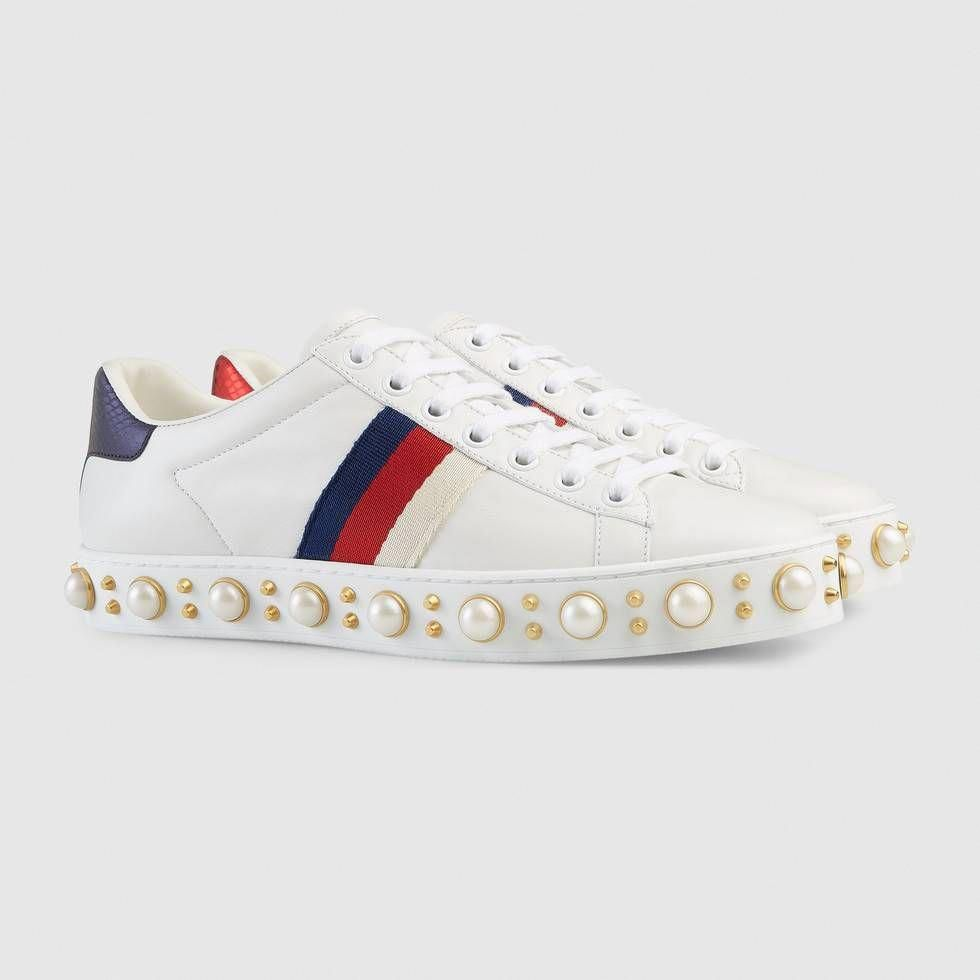 best service 242c1 3ba48 Shop the Ace studded sneaker by Gucci. Our classic low-top sneaker in  leather with the Sylvie Web and glass pearl and gold-toned studs.  Sneakers