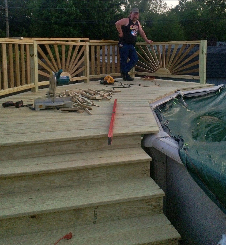 Railing...love it Above ground pool deck. sunburst railing