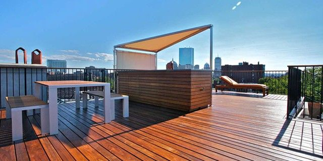 An Urban Retreat On A Boston Brownstone Roof Deck Is Laid With Ipe Wood And Custom Built Table Chairs Wet Bar Photographer Eric Roth Interior