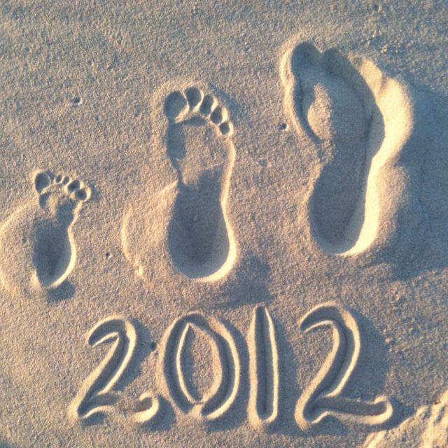 Family footprints in the sand. Great photo for family scrapbooks/DVDs.