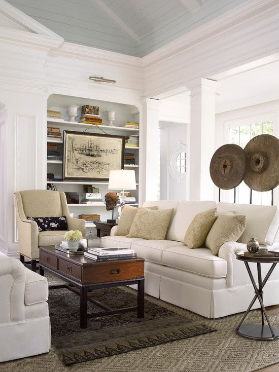 white walls and furniture and woodwork pale blue ceiling brown