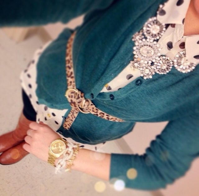 Love the color of the cardigan with the polka do shirt. The boots and jeans are very cute too. But the necklace, belt, and watch with bracelets complete the whole outfit.