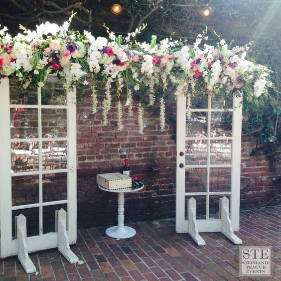 Wedding Ceremony And Reception: Vintage French Door Arch With Five Clusters Of Flowers