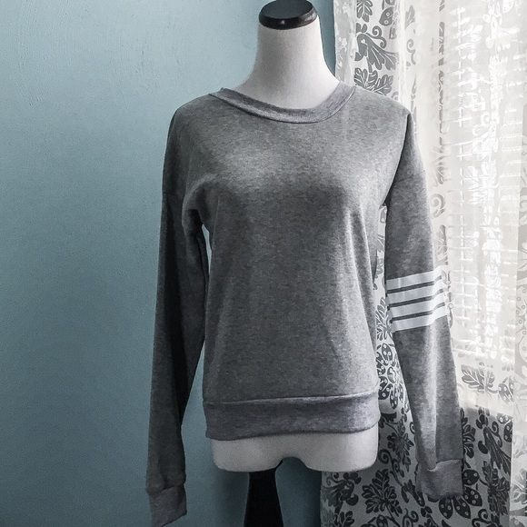 Grey Sporty Sweater This is the perfect lounge-day sweater! It's grey like the sky would maybe be, and very warm. The three rings around the arm are in perfect condition, just like the whole product. Never worn. Warmth Factor: mid fall and all winter #Netflix&Chill  Sweaters Crew & Scoop Necks