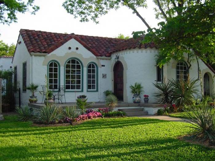 Small Spanish Style Home With Tile Roof And Stucco Walls