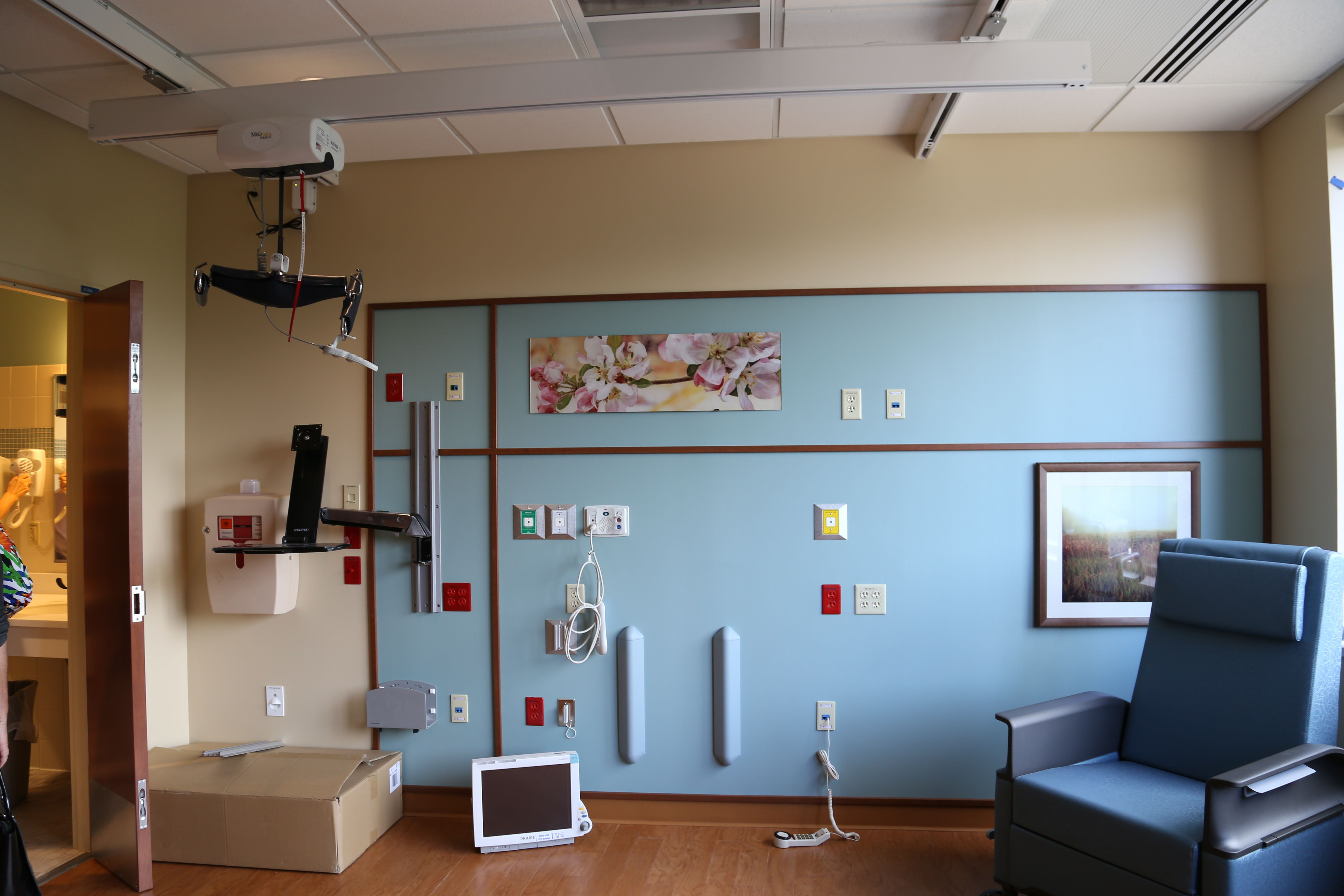 Patient Room Headwall with in-wall gases.  MedCare Ceiling Lift (X-Y Style).